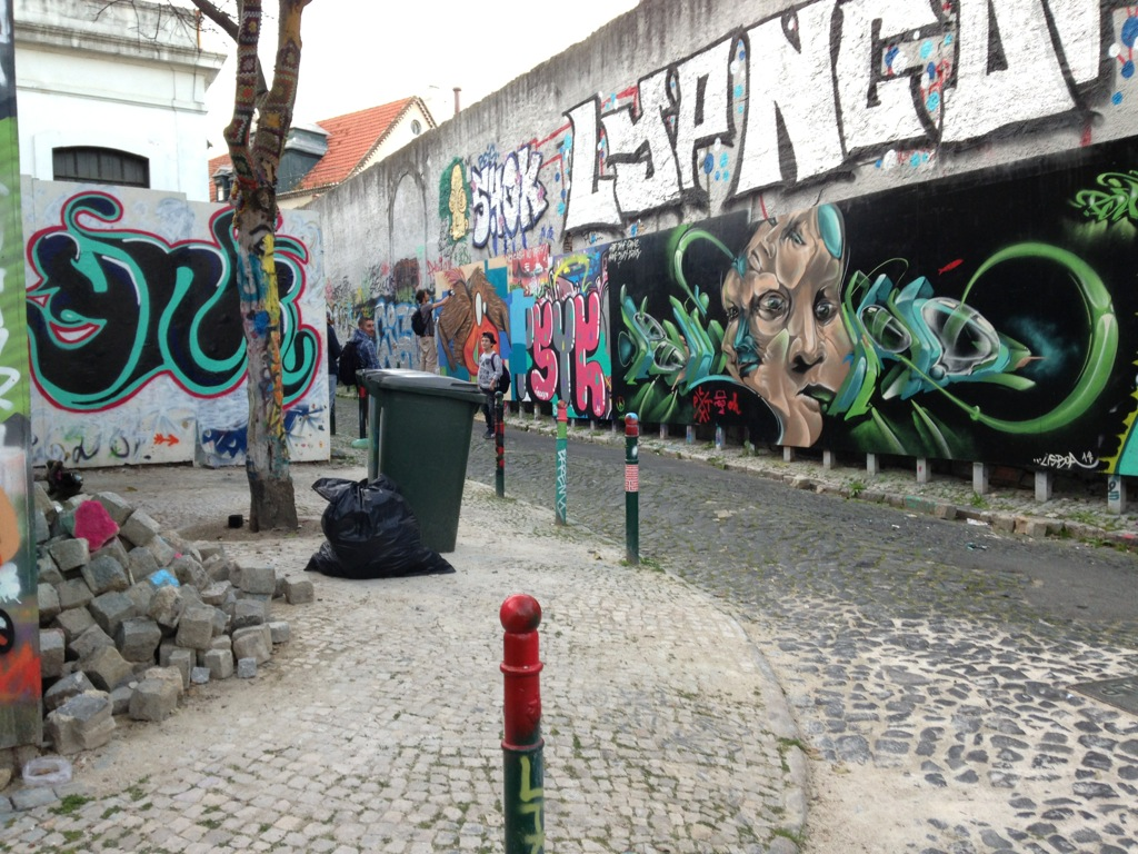 Graffiti Artists at work in a plywood alleyway gallery, Bairro Alto district, Lisbon