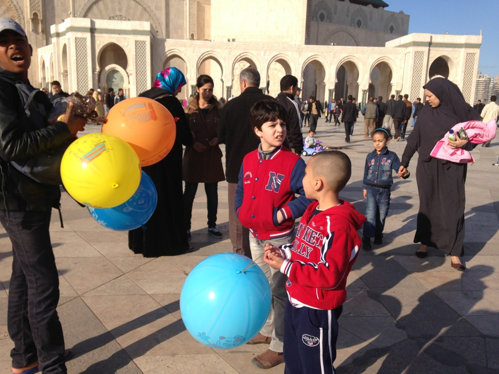 Balloon sellers work the crowds outside Casablanca's Grand Mosque