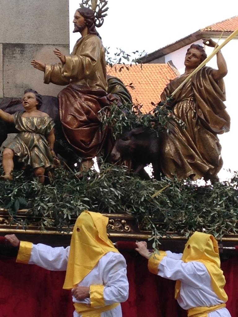 Hooded men carry a Semana Santa processional float