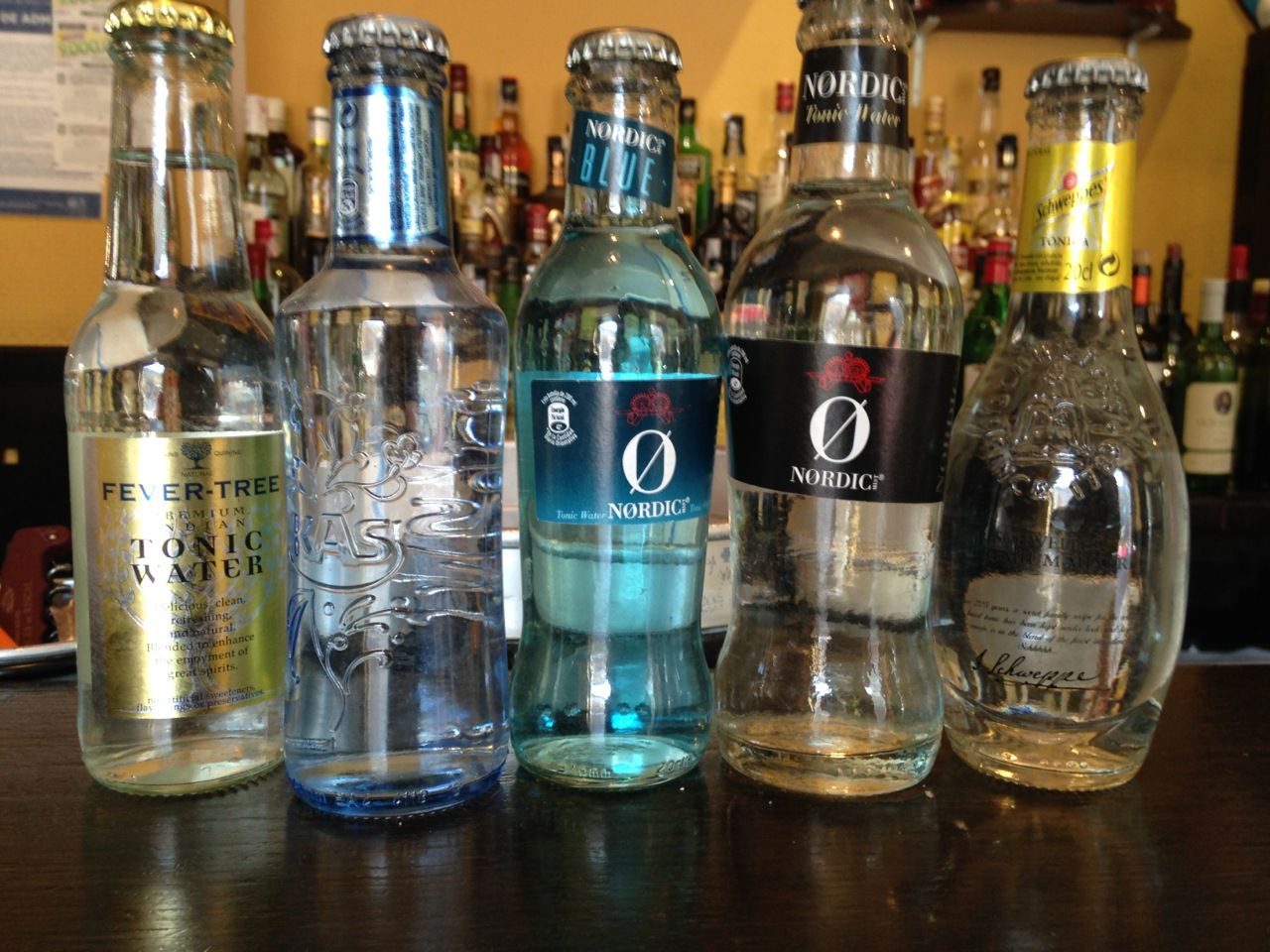 A lineup of five different tonics in Cafe La Ville in Ribadasella, Spain: Fever-Tree, __, Nordic Blue, Nordic, and Schweppes.