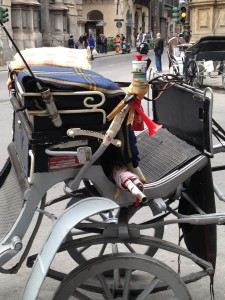 A cheery red air horn on a carriage in Palermo, Sicily.