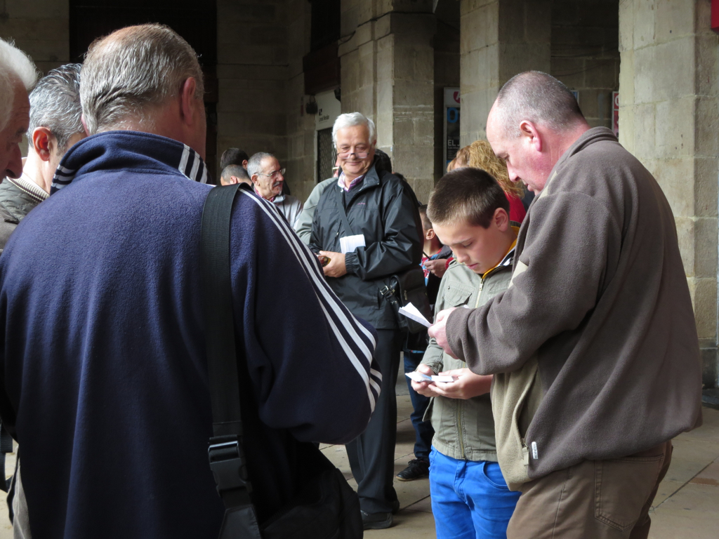 Football card collectors of all ages negotiate swaps at Bilbao's Sunday flea market