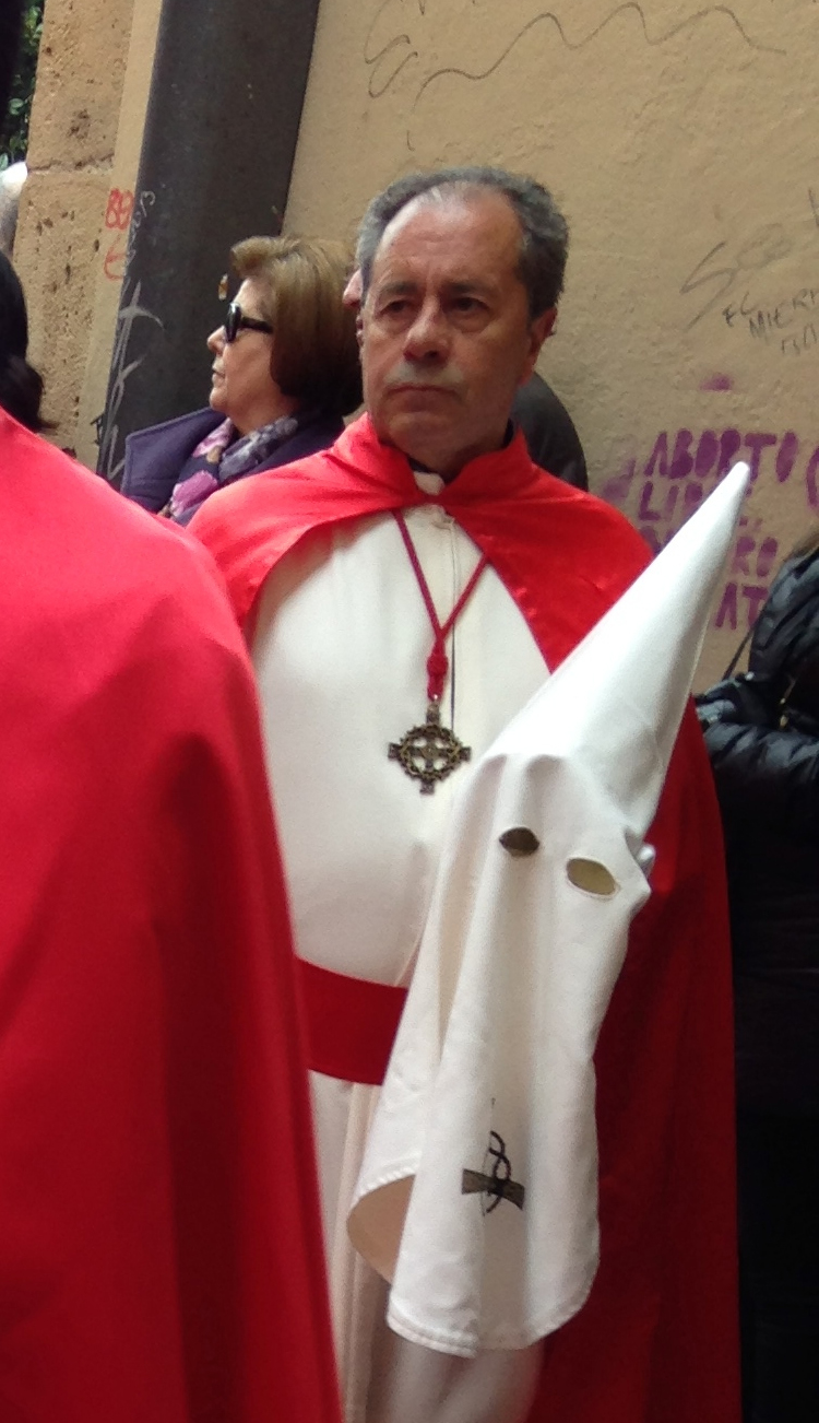 A marcher in Oviedo on Easter Sunday, capirote removed.