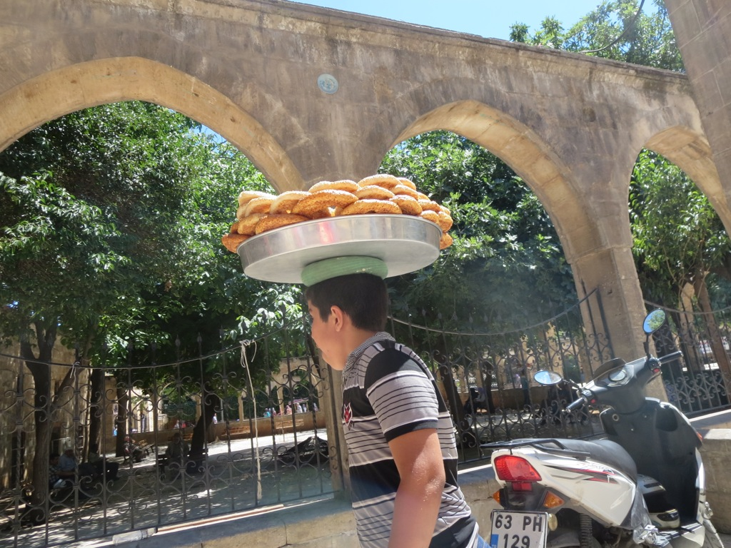 A working boy sells simit, Urfa, Turkey
