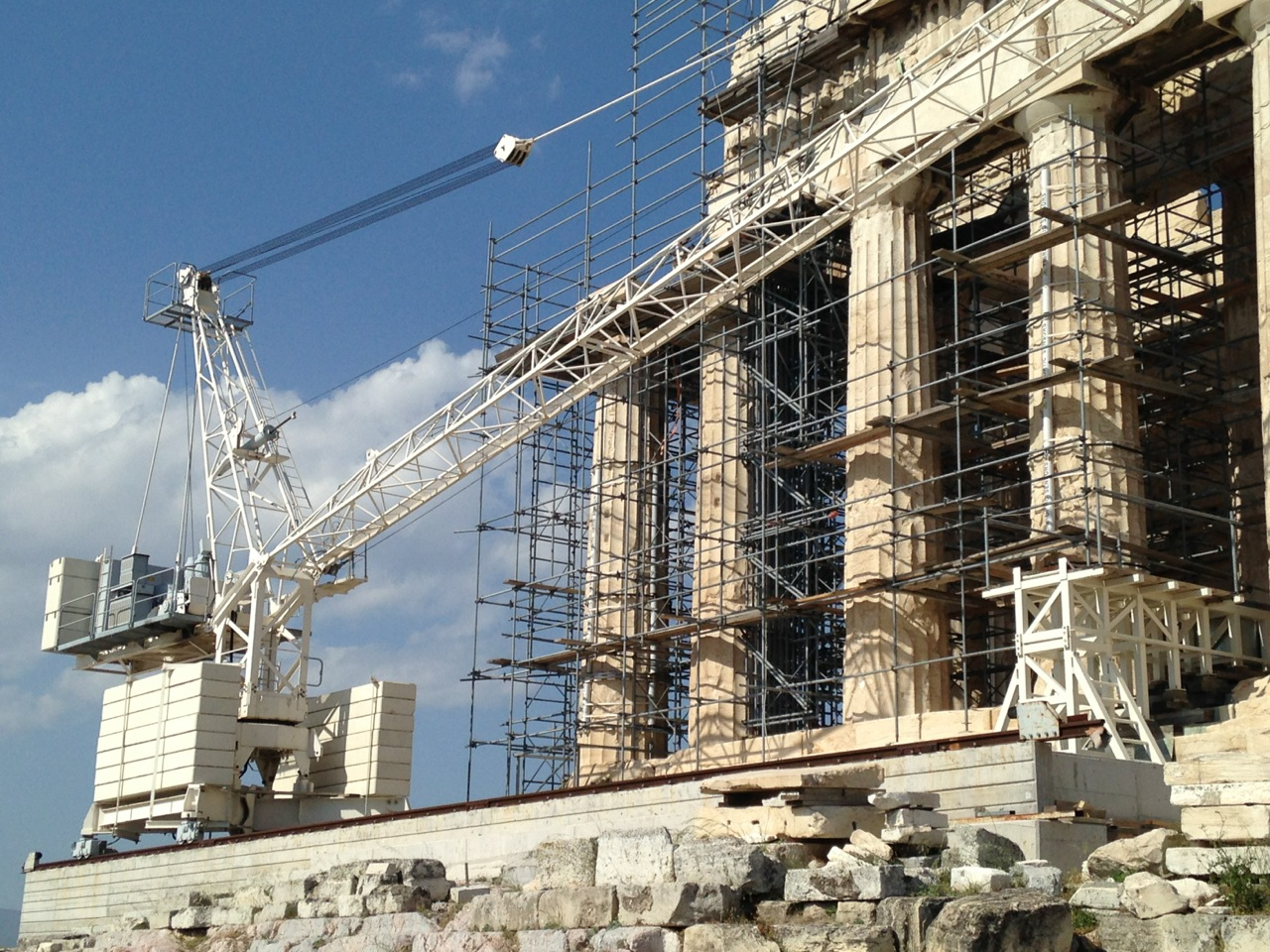 A construction crane and scaffolding at the west end of the Parthenon at the Acropolis in Athens, Greece.