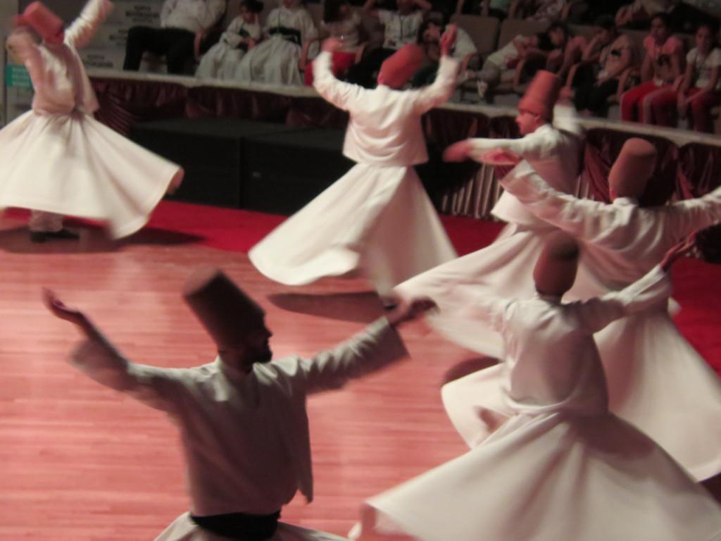 Semazens--sufi dancers--twirl around the hall in Konya, Turkey.