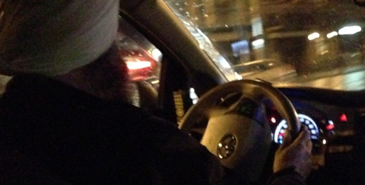 Sikh taxi driver and steering wheel.