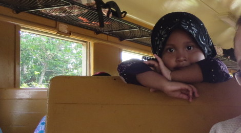 A Girl Wears Hijab on a Train In Southern Thailand