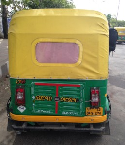 Green Indian Tuk Tuk With a CNG Sticker