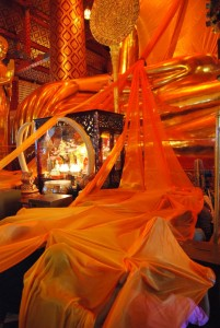 Golden Cloth Covers Worshipers at Wat Phanan Choeng