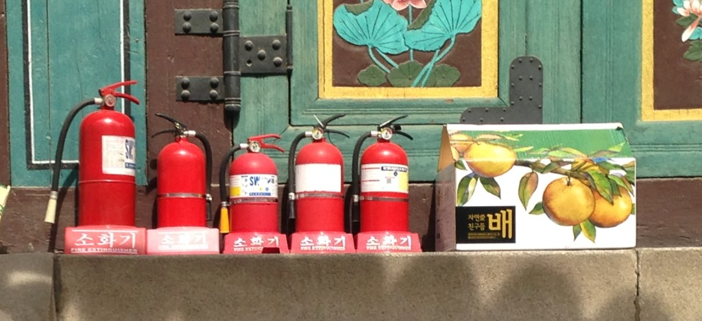 Five Extinguishers and a Apple Box At