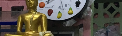 A clock with fruits where numbers are normally seen.