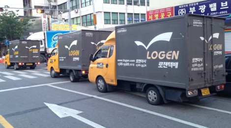 Trucks Await Deliveries From Alley-Bound Distributors in Seoul, South Korea